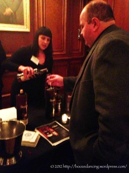 A whisky aficionado sampling some of Glenfiddich's finest.