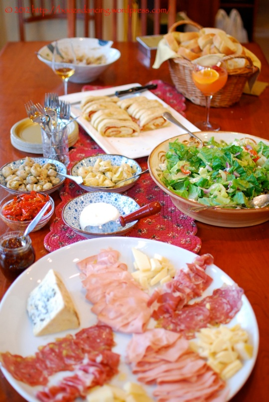 The lunch time spread! Cured meats. Cheeses. Salads. Stromboli. Marinated vegetables. Oh my!