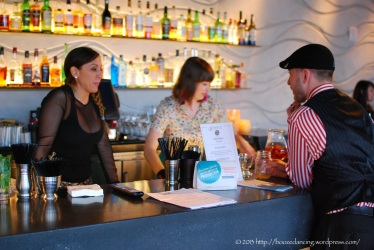 Noelle Ferrazzano and Bess Gulliver of the Stratus Rooftop Lounge chatting with Nate Churchill of XIX.