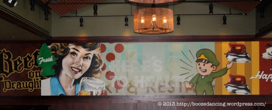 The mural along the back wall. The muralist also provides the art for the bottles.