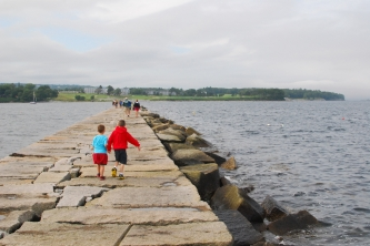 The Boys walking along the Rockland Breakwater