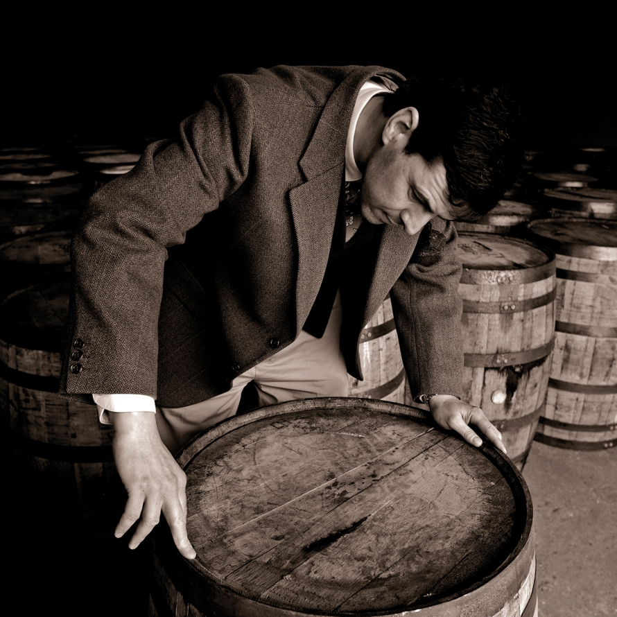 04 Dr Bill Lumsden, Director of Whisky Creation at Glenmorangie, inspecting a cask