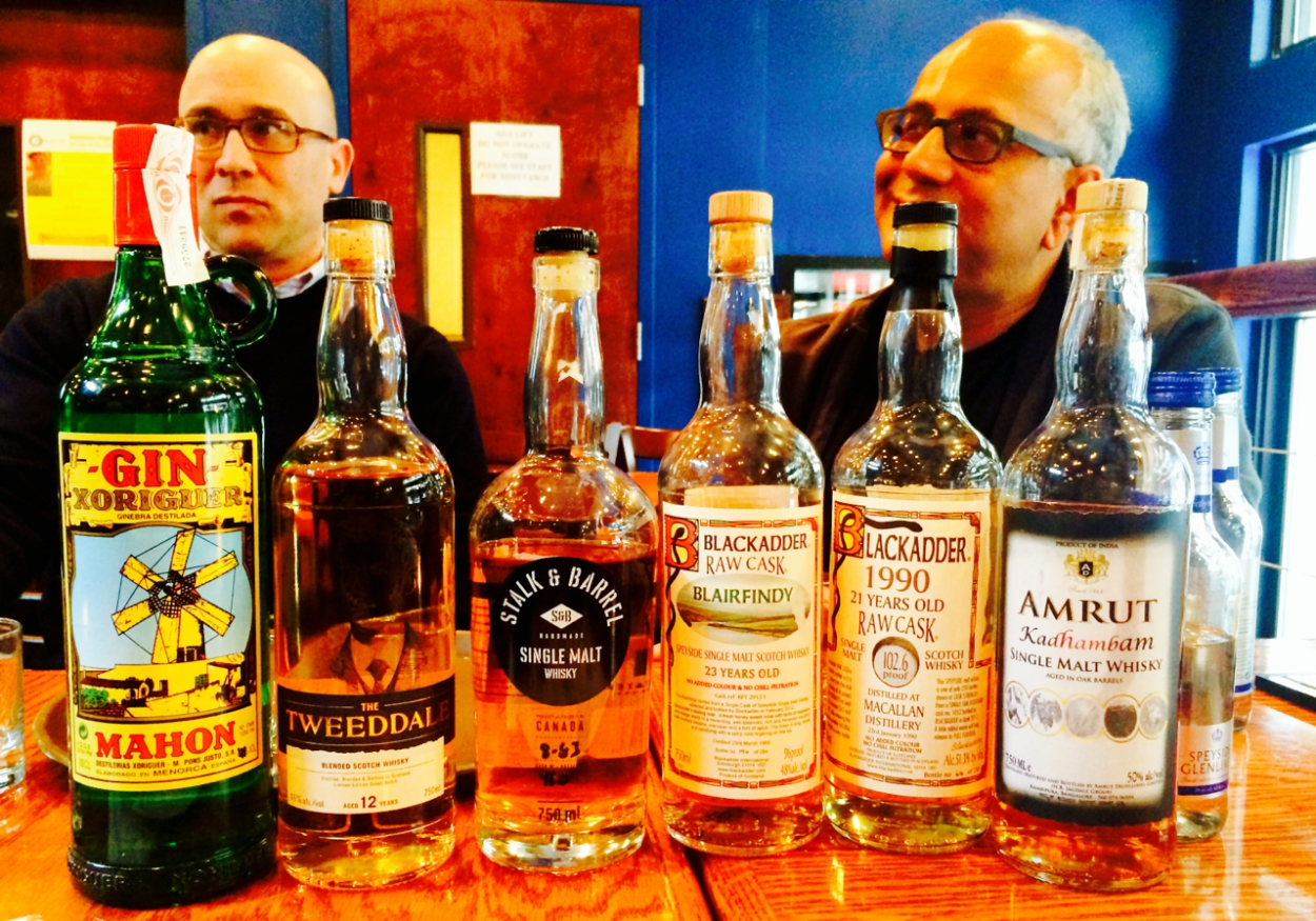 Mark Monaco and Whisky Raj hiding behind the afternoon's libation selections.